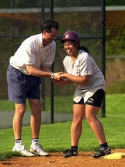 Former Scarsdale softball coach David Scagnelli congratulates