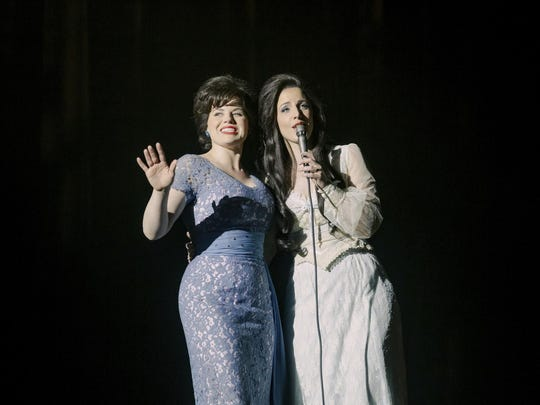 """This image released by Lifetime shows Megan Hilty as Patsy Cline, left, and Jessie Mueller as Loretta Lynn in a scene from the film """"Patsy & Loretta,"""" premiering Oct. 19. (Jake Giles Netter/Lifetime via AP)"""