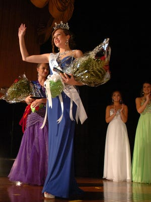 Miss Farmington 2015 Sidney Schrand waves to the audience during last year's pageant.
