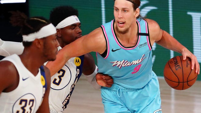 Miami Heat forward Kelly Olynyk (9) dribbles against Indiana Pacers guard Aaron Holiday (3) during the second half of an NBA basketball game Monday, Aug. 10, 2020, in Lake Buena Vista, Fla.