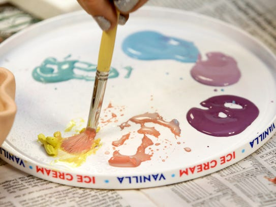 Glazing colors during a ceramics class at WHAM Community