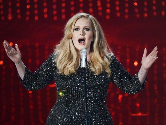 Adele performs onstage during the Academy Awards on Feb. 24, 2013, in Los Angeles.
