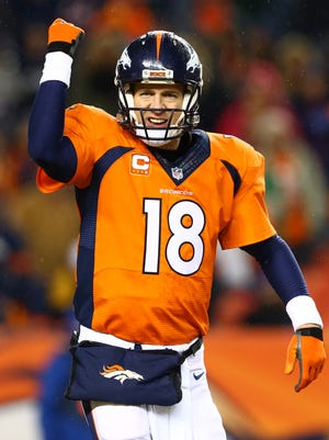 Denver Broncos quarterback Peyton Manning (18) reacts in the fourth quarter against the Indianapolis Colts in the 2014 AFC Divisional playoff football game at Sports Authority Field at Mile High.