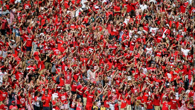 "University of Wisconsin student band plays ""Jump Around,"" a popular event of UW football games on Saturday, September 17, 2016, at Camp Randall Stadium in Madison. Milwaukee Journal Sentinel photo by Rick Wood/RWOOD@JOURNALSENTINEL.COM ORG XMIT: 00089497A"