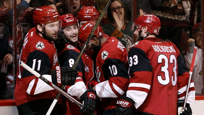 Coyotes' Anthony Duclair (10) celebrates with teammates Martin Hanzal (11), Tobias Rieder (8), Luke Schenn (2) and Alex Goligoski (33) after his second-period goal against the Stars, Tuesday, Dec. 27, 2016, in Glendale, Ariz.