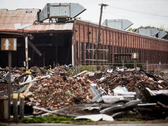 Construction crews continue to dismantle the former BorgWarner plant on Kilgore Avenue Tuesday, Oct. 10, 2017.