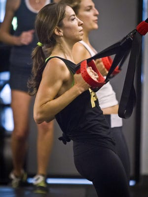 Kari Saitowitz, owner of the Fhitting Room boutique fitness studio, works out with a class at one of gym's three New York locations.