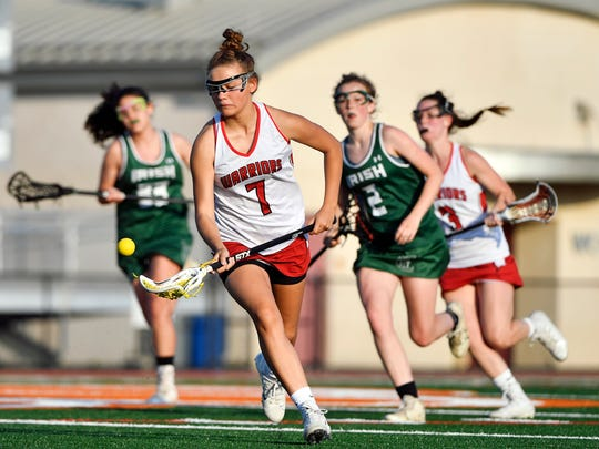 Susquehannock's Kenna Hancock gains possession against York Catholic in the second half of a girls' lacrosse YAIAA semifinal game Wednesday, May 9, 2018, at Central York. Susquehannock defeated York Catholic 11-5 to advance to the YAIAA title game.
