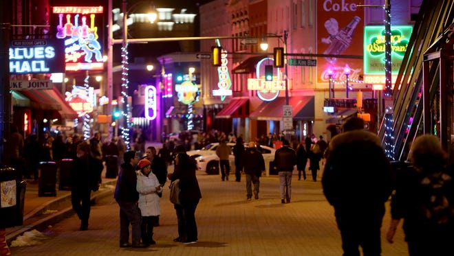 January 19, 2018 - People mingle on Beale St. during the 2018 International Blues Challenge on Friday night. This is the 34th year Blues musicians from around the world come to Memphis to compete for cash, prizes, and industry recognition. The world's largest gathering of Blues acts represents an international search by The Blues Foundation and its affiliated organizations for the Blues Band and Solo/Duo Blues Act ready to take their act to the international stage.
