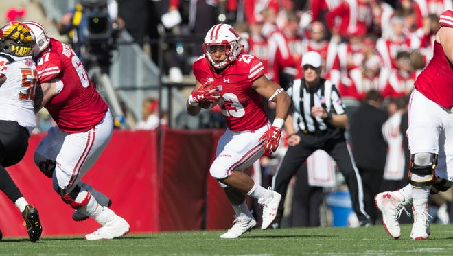 Wisconsin Badgers running back Jonathan Taylor (23) rushes with the football during the second quarter against the Maryland Terrapins at Camp Randall Stadium.