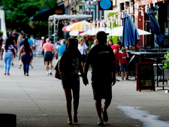 A couple walks through Market Square in Knoxville,