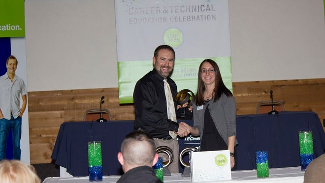 Manitowoc Lutheran High teacher Martin Plocher accepts his Top Tech Award from Lakeshore Technical College at the Lakeshore Culinary Institute in Sheboygan.