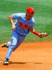 Ole Miss shortstop Grae Kessinger fields a ground ball before throwing Texas A&M's Chris Andritsos out at first during the second inning of a Southeastern Conference tournament NCAA college baseball game, Saturday, May 26, 2018, in Hoover, Ala. (AP Photo/Butch Dill)