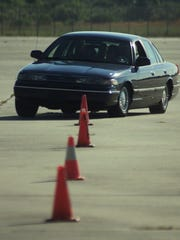 Citizens Police Academy students weave through cones