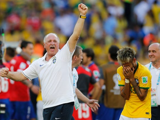 Brazil's coach Luiz Felipe Scolari, left, and Brazil's Neymar react at the end of the penalties shoot-out during the World Cup round of 16 soccer match between Brazil and Chile at the Mineirao Stadium in Belo Horizonte, Brazil, Saturday, June 28, 2014. Brazil won 3-2 on penalties.(AP Photo/Frank Augstein)