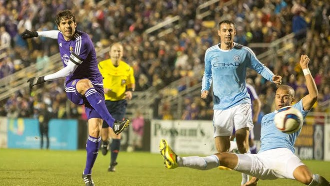 FILE- Orlando City's Kaká shoots past New York City defenders.