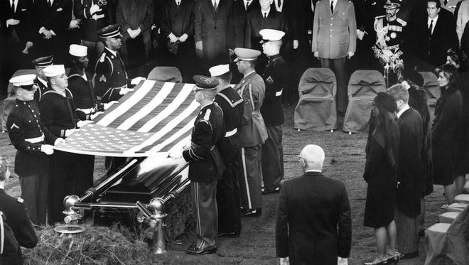 The burial and folding of the flag ceremony for President John F. Kennedy at his grave site in Arlington National Cemetery on Nov. 25, 1963.