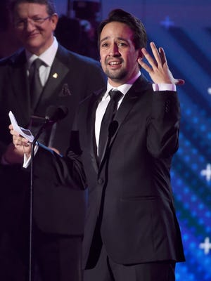 Lin-Manuel Miranda accepts the Latin Recording Academy president's merit award at the 18th annual Latin Grammy Awards.