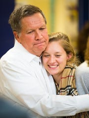 Ohio Governor John Kasich hugs his daughter, Emma, after a town hall at Lebanon Senior Center in Lebanon, New Hampshire Monday, January 18, 2016.