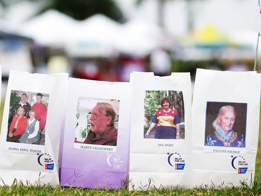 KINFAY MOROTI/THE NEWS-PRESS... Family and friends lost to cancer were honored Saturday (3/2/16) during the Fort Myers Relay for Life festival at Lakes Regional Park.