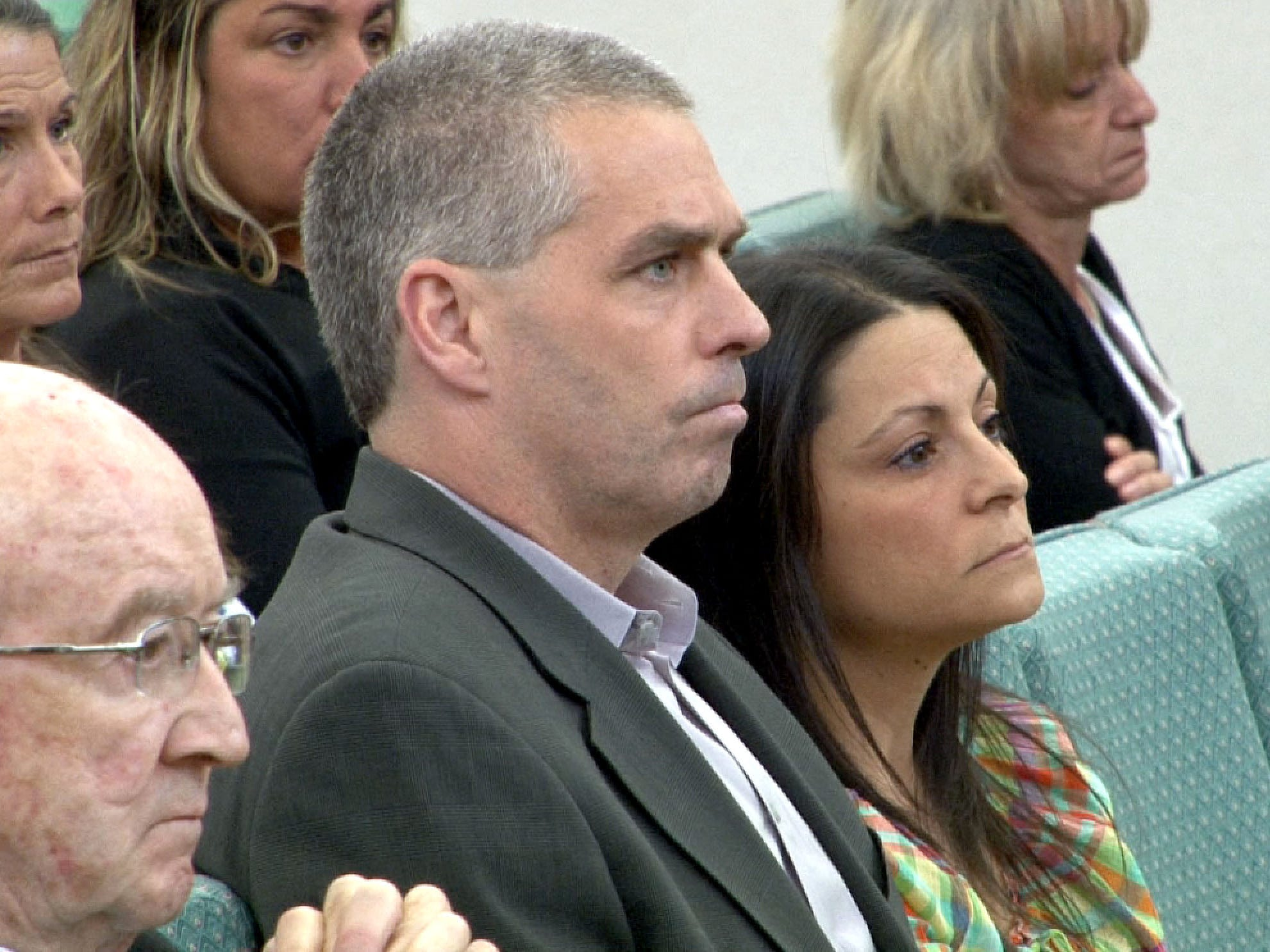 Former NJ Devils player and current Pt Pleasant-Manasquan High School hockey coach Jim Dowd sits with his wife Lisa in Wall Township Municipal Court Wednesday, May 20, 2015. He was found not guilty on a complaint charged that Dowd kicked one of his players in the back during a hockey game. ASB 0521 Jim Dowd DOWDVERDICT0520B WALL TOWNSHIP, NJ STAFF PHOTO BY THOMAS P. COSTELLO
