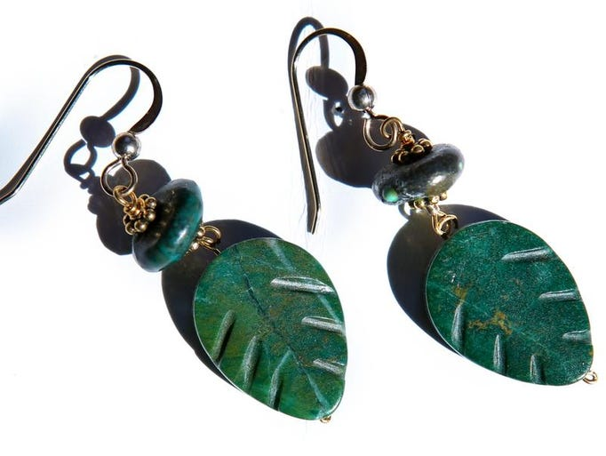 Green jade earrings at Cecilia's in the Mellwood Arts Center. March 13, 2014