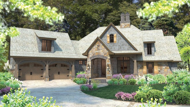 Gorgeous stone and charming shutters give an Old World feeling to the exterior of this unique home.