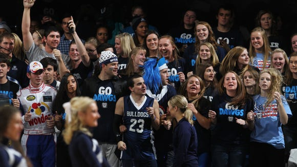 Butler University students show their spirit at the Tip-Off party Bulldog basketball scrimmage game at Hinkle Fieldhouse in Indianapolis on Friday, October 25, 2013. Butler begins a new basketball season with a new head coach, former player Brandon Miller, as well as lots of new players and a new conference (Big East). Fans were invited to the Tip-Off party Friday night to promote excitement for the season.