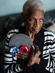 Dorothy Weems of Detroit holds old film footage she