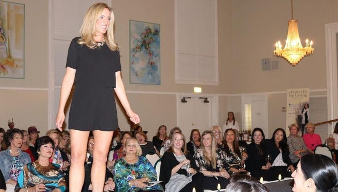 """Katie Browning walks the aisle at the """"A Perfect Fit for Giving"""" Style Show at the Abilene Woman's Club."""