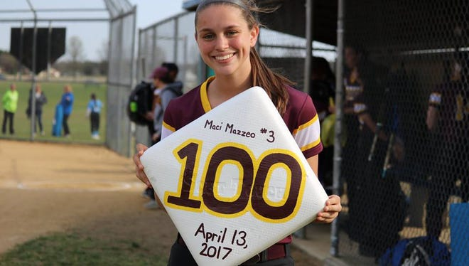 Glassboro senior Maciana Mazzeo holds a base that commemorates her 100th stolen bag on April 13 this season. Mazzeo also notched her 100th hit five days later.