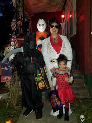 Katie Pittsley of Taunton dresses as Elvis for Halloween with her family every year.