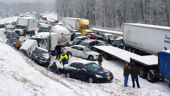 Vehicles are piled up at mile marker 286 on the Pennsylvania Turnpike, a mile outside Reading, Pa., on Dec. 26, 2013.