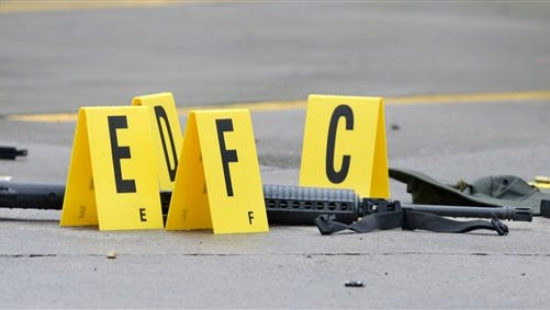 A weapon lays on the ground next to evidence markers in Bristol, Tenn., on Thursday, July 7, 2016.