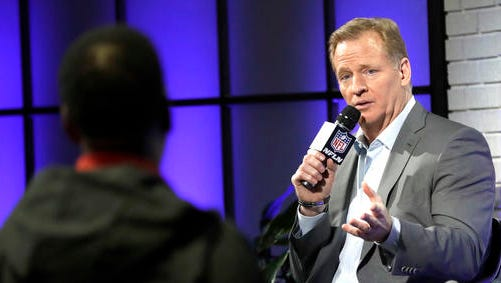 NFL Commissioner Roger Goodell, right, answers a question from a fan about marijuana use during a fan forum for the NFL Super Bowl 51 football game Friday, Feb. 3, 2017, in Houston.