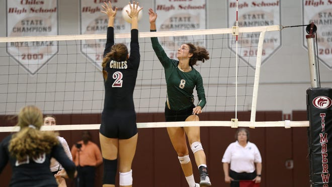 Lincoln's Madison Fitzpatrick spikes the ball as Chiles' Katie Howell defends during their District 2-8A semifinal game on Tuesday. Fitzpatrick had 24 kills and 16 digs as the Trojans swept, 3-0.