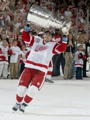 Red Wings Sergei Fedorov hold the Stanley Cup after