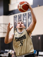 Senior guard Dakota Mathias with a layup during Purdue