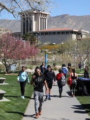 UTEP students walk through Leech Grove on campus during