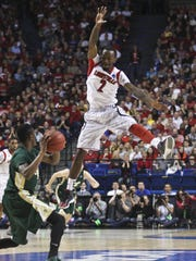 Louisville's Russ Smith pressures Colorado State's
