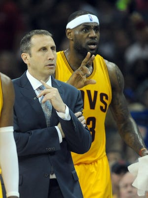 Cleveland Cavaliers head coach David Blatt and  forward LeBron James (23) argue a call during the second quarter against the Chicago Bulls in game two of the second round of the NBA Playoffs at Quicken Loans Arena.
