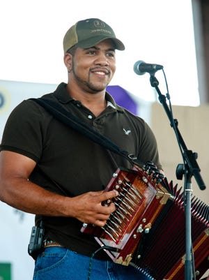 Wayne and Same Ol' 2-Step entertain Saturday at the free Zydeco Breakfast in downtown Opelousas.