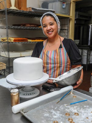 Cake decorator Christine Oftana Rosario feels comfortable in her environment of sugar, flour and fondant at the Guam Bakery in Dededo on April 7.