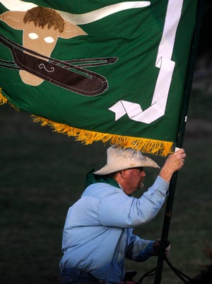 John Caldwell carries the flag of the Fort Griffin Fandangle into the Prairie Theater in a 2015 performance.