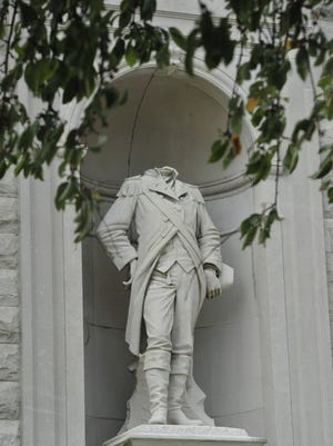 Officials are still searching for the person who knocked the head off the Col. William Crawford statue at the county's courthouse.