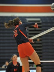 Marisa Gwinner smashes one over the net in the opening game against River Valley, she led the team in kills with 17.