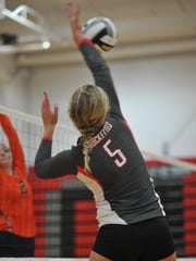 Buckeye Central's Jenna Karl smashes one across the court against Galion.