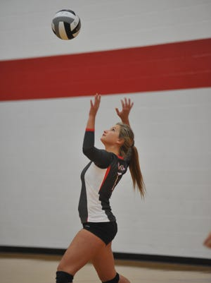 Spencer Kaple serves in the first game of the Buckettes' match against Galion.