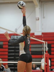 Jenna Karl tips one over the net against Carey.