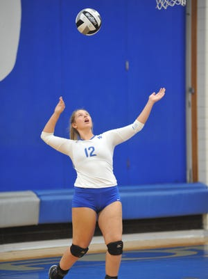 Gabby Grove serves in the third game against Buckeye Central.